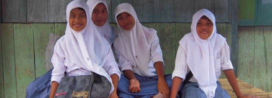Girls waiting for the Bus in Hu'u, Sumbawa, Indonesia